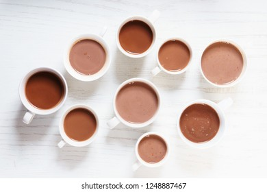 hot chocolate drinks in white cup on white wooden table