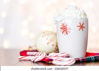 Hot chocolate garnished with whipped cream and crashed peppermint candies.