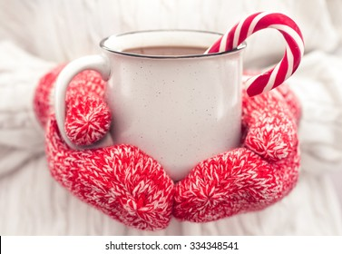 Hot chocolate in the hands. Close up