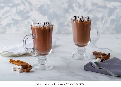 hot chocolate with marshmallow in a clear glass with chocolate sause.