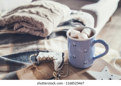 Hot chocolate with marshmallow in cozy home interior
