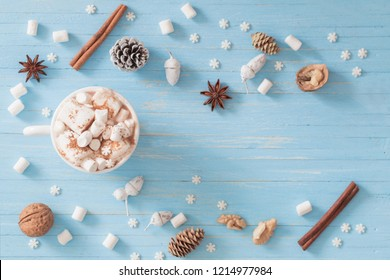 hot chocolate with marshmallow on blue wooden background