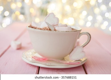 Hot chocolate with marshmallows on pink rustic background