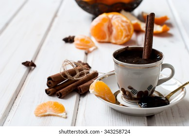 Hot chocolate with orange and cinnamon Still life with autumn leaves