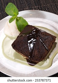Hot chocolate pudding with fondant centre with ice cream, close-up