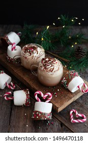 Hot chocolate topped with whipped cream and marshmallows