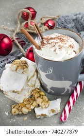Hot chocolate with whipped cream, cinnamon and turron.winer holidays mood