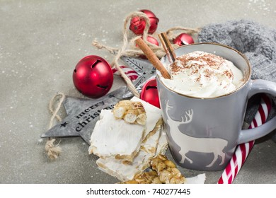 Hot chocolate with whipped cream, cinnamon and turron.winter holidays mood
