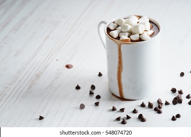 hot chocolate in white cup with marshmallows and chocolate chip