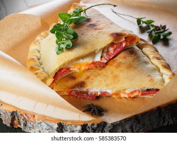 Hot Closed Calzone Pizza on the wood slice Ready to Eat