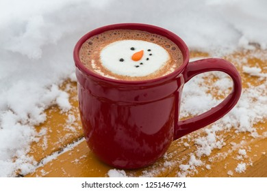 hot cocoa beverage mixed with Irish whiskey garnished with a smiling snow-person marshmallow