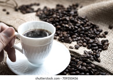 Hot coffee. Coffee beans. Harvest of coffee beans.