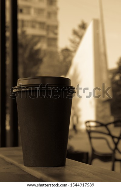 hot-coffee-black-paper-cup-600w-15449175