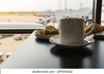 Hot coffee with breakfast at airport lounge.