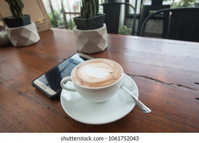 Hot coffee in  cafe on table