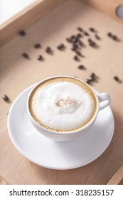 Hot Coffee Cappuccino  White Cup and Coffee Bean on Wooden Tray