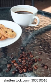 Hot coffee with chocolate cookies