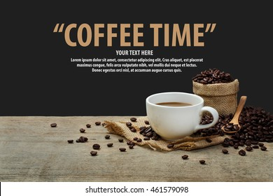Hot Coffee cup with coffee beans on the wooden table and the black background with copy space for your text