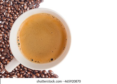 Hot coffee cup with clipping path and coffee beans top view on white background
