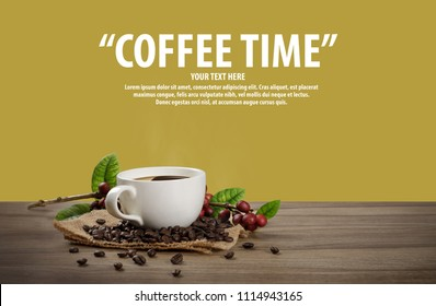 Hot coffee cup with fresh organic red coffee beans and coffee roasts on the wooden table and the yellow background with copy space for your text.