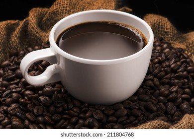 Hot Coffee Cup on Coffee Beans in Bag