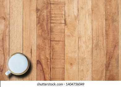 Hot coffee in cup on desk, copy space, top view