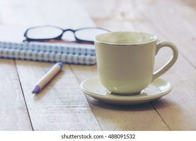 Hot coffee cup on office desk ,Thinking business project comcept