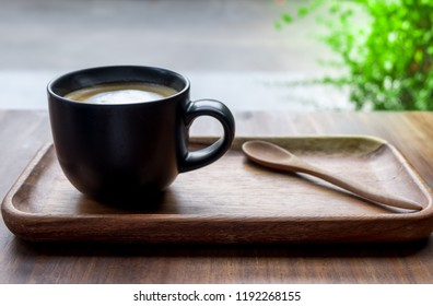 hot coffee cup on wooden background