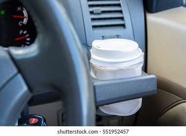 hot coffee to go at cup holder in a car.