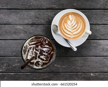 Hot coffee and Iced coffee on wood table , top view