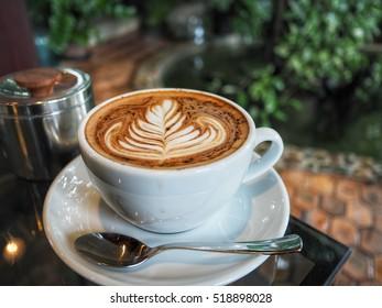 hot coffee latte art in the garden
