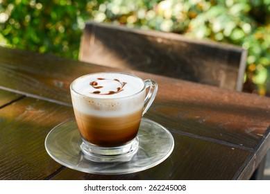 Hot coffee latte art on table