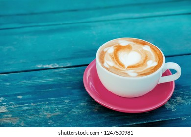 Hot Coffee Latte Cup on Wooden Table with Copy Space. Top View