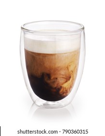 Hot coffee with milk in a glass with double walls isolated on white background.