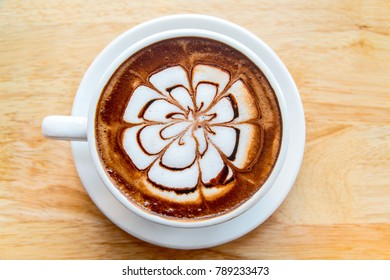 hot coffee mocha latte on wooden table background