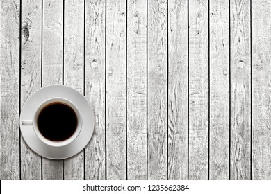 hot coffee on the table on a black background