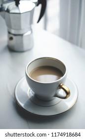 Hot coffee on the table near window