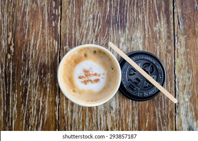 Hot coffee on wood background