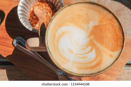 Hot coffee on wood table,Close up
