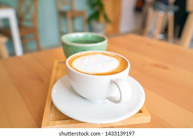 Hot coffee on wooden table.