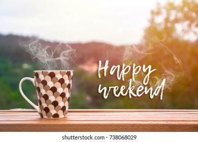 Hot Coffee over wooden board written HAPPY WEEKEND.