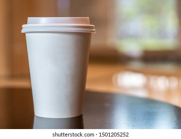 hot coffee paper cup in coffee shop and cafe
