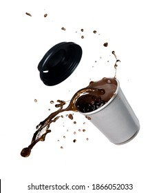 Hot coffee paper cup of spilling coffee creating splash on a white background.
