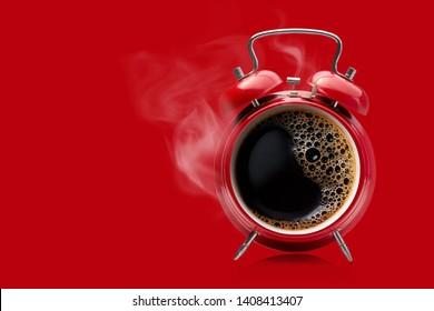 Hot coffee in a retro alarm clock. Wake up alarm coffee concept.