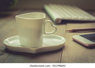 Hot coffee, smart phone and computer, working from home