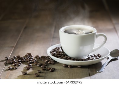 hot coffee with smoke on brown wood background