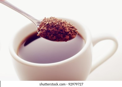 hot coffee and spoon with coffee