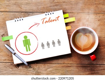 Hot coffee with talented person for hiring on wood background