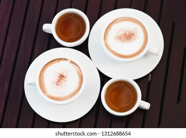 Hot coffee and tea on wood table
