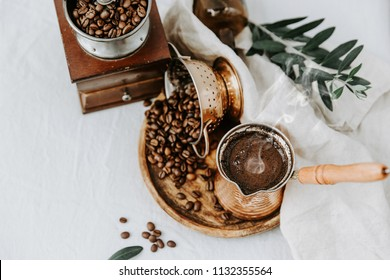 Hot coffee in Turkish Cooper and coffee beens on linen table